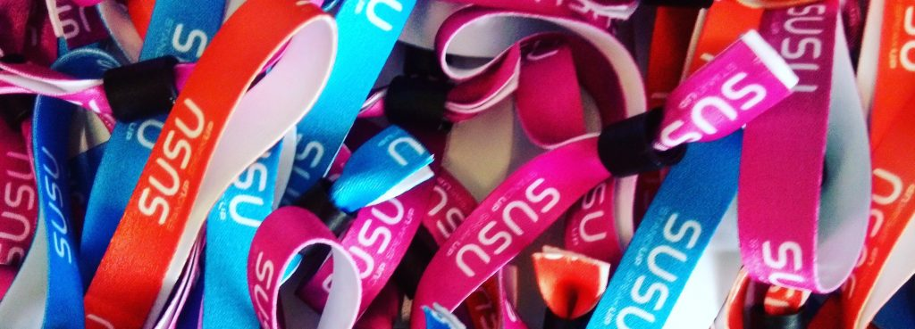 A pile of Stand Up Speak Up wristbands