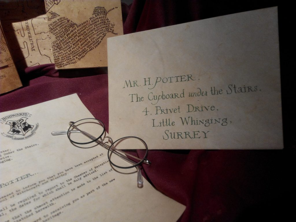 an envelope and a letter addressed to Harry Potter
