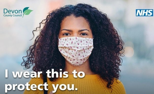 a woman wearing a face mask. A message says I wear this to protect you