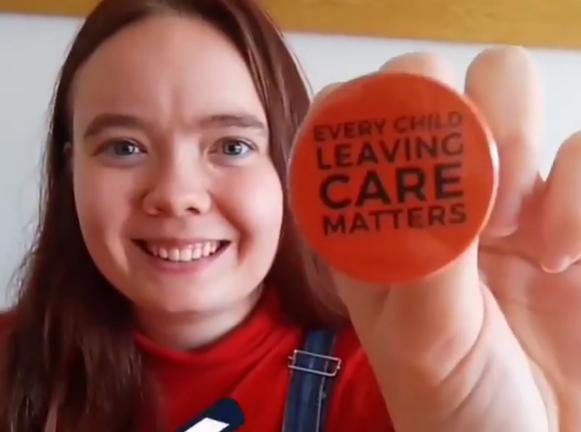 Zara holding a badge