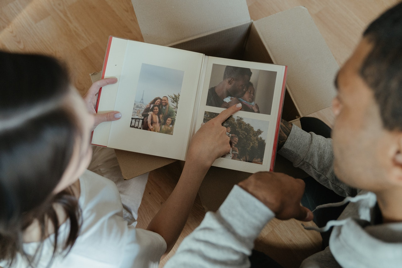 two people looking at a photo album